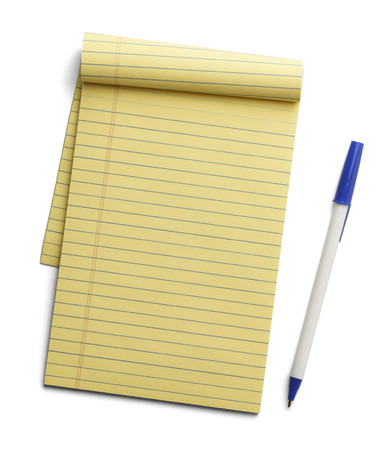 Yellow note pad with blue pen next to it isolated on white background.