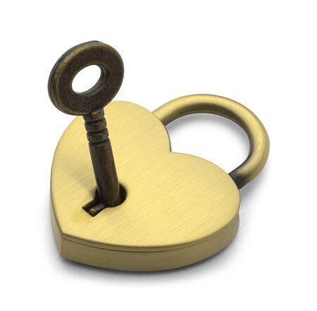 Brass Heart with Key Isolated on White Background.