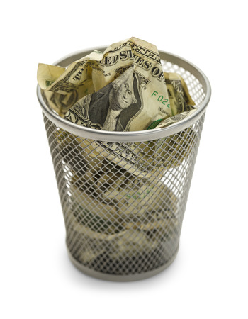 economic depression: Waste Basket Full of Money Isolated on White Background.