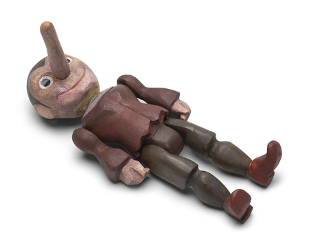 Laying Down Pinocchio Wood Doll Isolated on White Background. Banque d'images