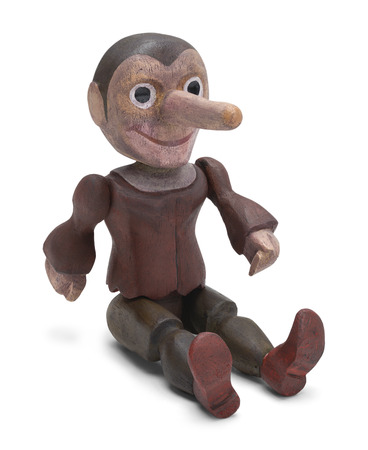 pinocchio: Sitting Pinocchio Wood Doll Isolated on White Background.