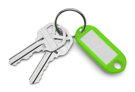 key chain: Green Key Chain Tag and Keys Isolated on White Background. Stock Photo