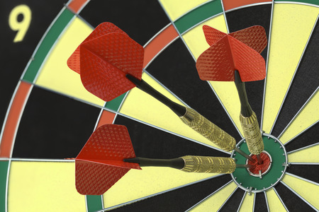 Three Darts in the Bulls Eye on Dart Board. Zdjęcie Seryjne