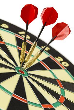 dart board: Three Darts in the Bulls Eye on Dart Board Isolated on White Background. Stock Photo
