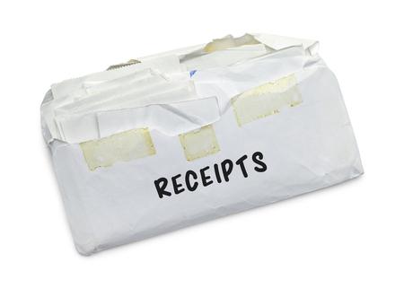 Envelope full of Receipts Isolated on White Background. Stock Photo