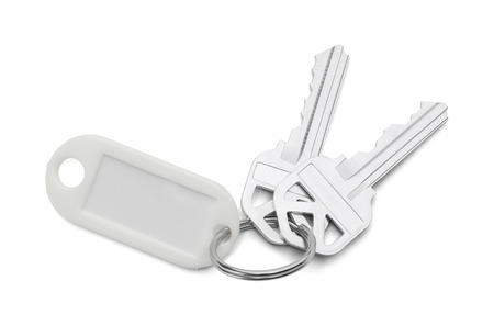 Pair of House Keys With White Key Chain Isolated on White Background.