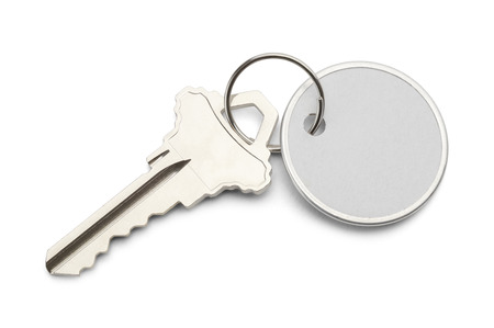 key chain: Circle Paper Tag with Copy Space and Key Isolated on White Background.