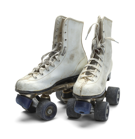 well loved: Two Worn Roller Skates Isolated on White Background. Stock Photo