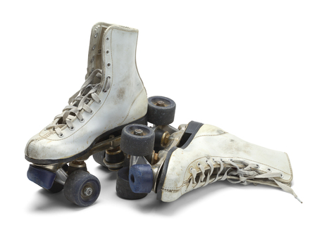 Two Worn Roller Skates Isolated on White Background. Stock Photo