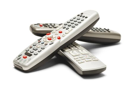 television remotes: Pile of TV Remote Controls Isolated on White Background. Stock Photo