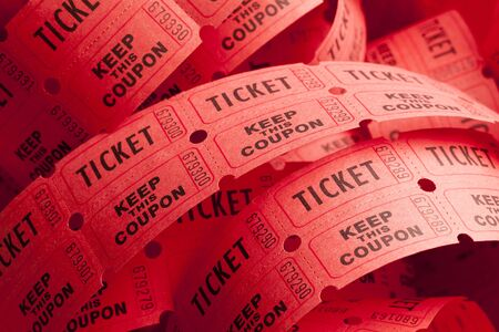 unwound: Unwound Messy Roll of Red Tickets Piled Up.