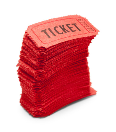 Stack of Red Tickets Tipping Over Isolated on White Background. Фото со стока
