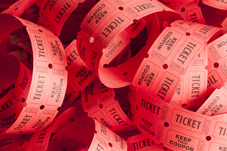 raffle ticket: Unwound Messy Roll of Red Tickets Piled Up.