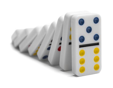 consequence: Dominoes Falling Down Isolated on White Background.