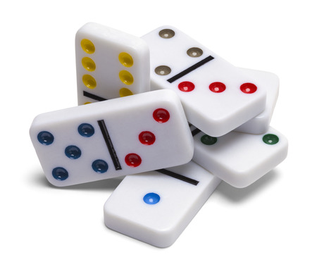 topple: Pile of Domino Pieces Isolated on White Background.