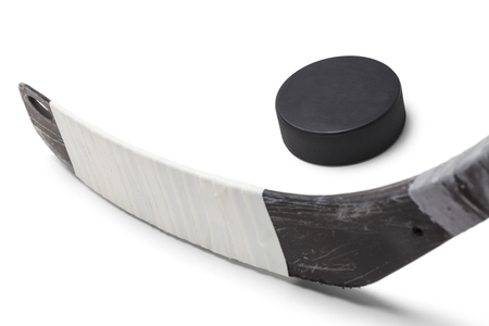 Ice Hockey Stick with Black Puck Isolated on White Background.