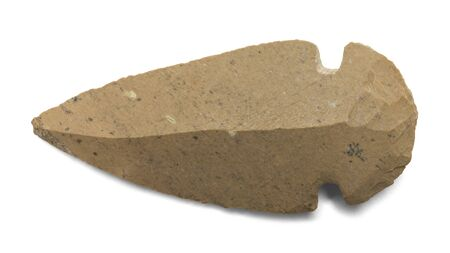 primitivism: Brown Stone Arrow Head Isolated on White Background. Stock Photo