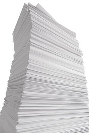 paper stack: Large Towering Stack of White Paper Isolated on White Background. Stock Photo