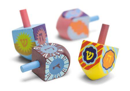 Wooden Toy Jewish Dreidals Isolated on White Background. Stock Photo
