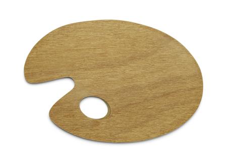 白い背景に分離されたコピー スペースを持つ木製ペイント パレットです。