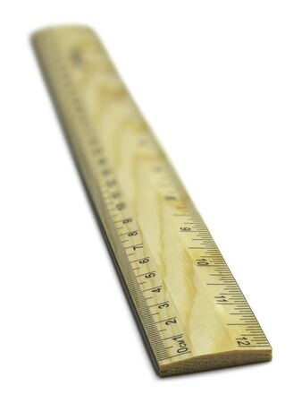 inches: Wooden School Ruler with Inches and Milimeters Isolated on White Background.