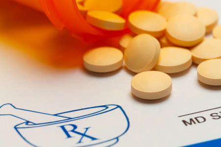 rx: Orange Pills Spilled on RX Medicine Prescription Doctors Note.