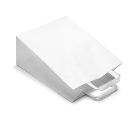 white paper bag: Tipped Over White Paper Bag Isolated on White Background.