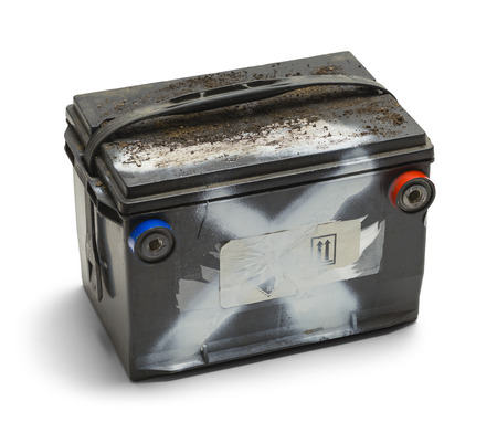 Old Dead Car Battery Isolated on White Background.