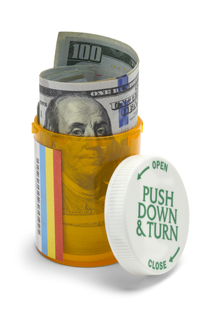 doctor with dollars: Pill Bottle with Hundreds of Dollars Isolated on White Background.