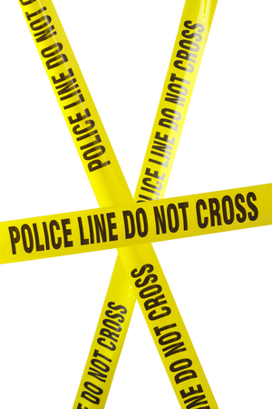 Yellow Police Line Cordon Tape Isolated on White. Stock Photo