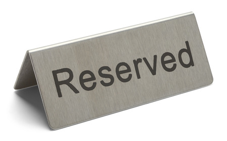 reserved sign: Metal Table Reserved Sign Isolated on White Background.