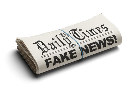 Fake News in The Daily Times Isolated on White Background.