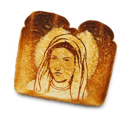 manifest: Virgin Mary Image on Burnt Toast Isolated on White Background.