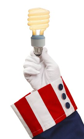 outs: President Holding Energy Saver Light Bulb Isolated on White Background.