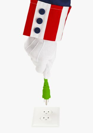 President Holding Green Electrical Plug Over Socket Isolated on White.