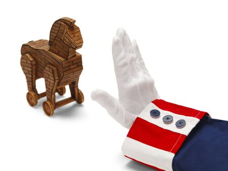 President With Stop Hand to Wooden Trojan Horse Isolated on White.