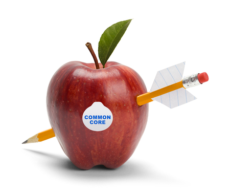 Apple with Common Core Sticker Shot by Pencil Arrow Isolated on White. Stock Photo