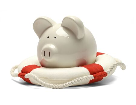 Piggy Bank Saved by a Life Preserver Isolated on White Background.