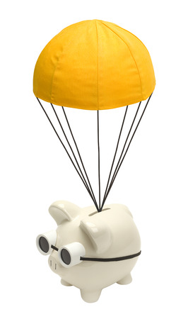 Piggy Bank Floating Down with Golden Parachute Isolated on White.