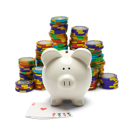 Piggy Bank with Four Aces and Poker Chips Isolated on White.