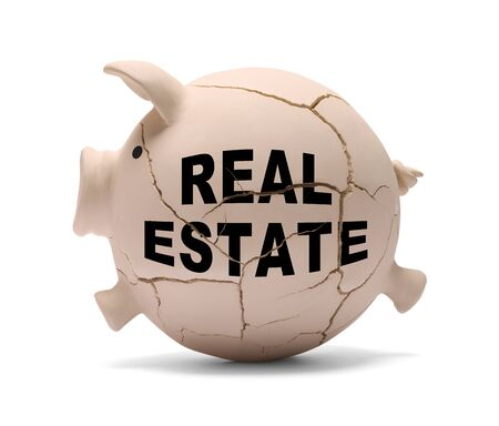 Real Estate Piggy Bank Cracking Apart Isolated on White Background.