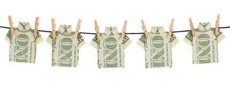 cleaning debt: Dollar Bill Shirts Hanging Out to Dry Isolated on White Background.