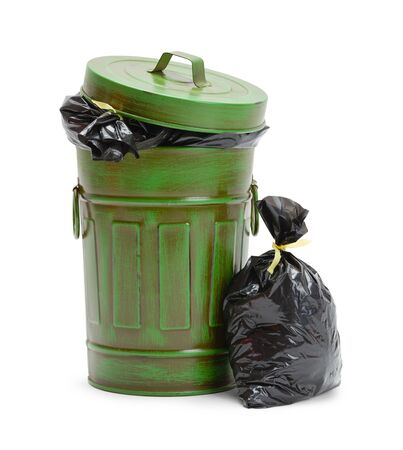Full Green Trash Can with Garbage Bags Isolated on White Background. Stock Photo
