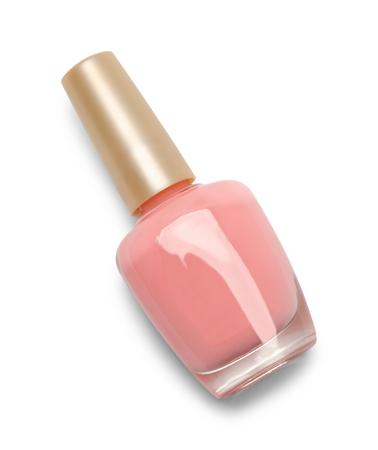 ピンクのマニキュアが白い背景で隔離のクローズド ボトル。 写真素材