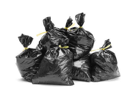 Large Group of Full Garbage Bags in a Pile Isolated on White Background.