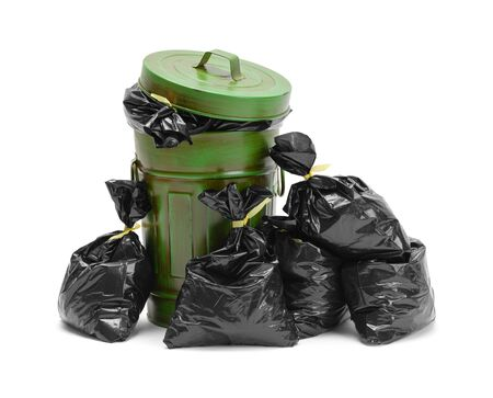 Garbage Can and Pile of Trash Bags Isolated on White Background. Stock Photo