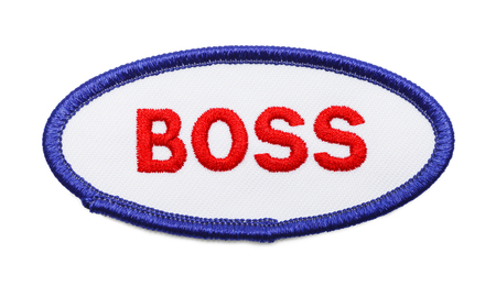 Oval Boss Uniform Work Patch Isolated on White Background. Stock Photo