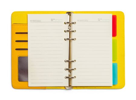 Open Yellow Planner Oragnizer Isolated on White Background.
