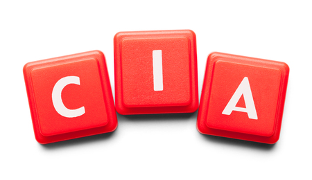 CIA Spelled with Wood Tiles Isolated on a White Background. Banco de Imagens