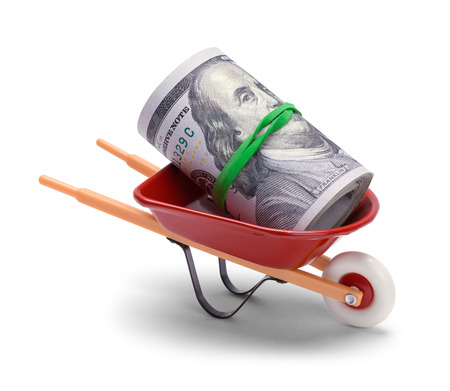 Red Wheel Barrow With a Roll of Hundred Dollar Bills.
